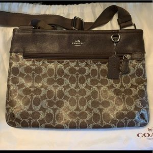 Unique Coach crossbody with dust cover